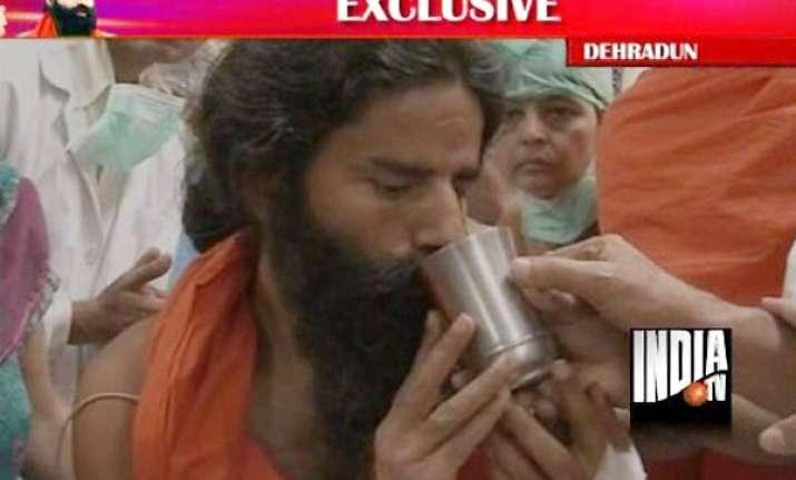 ramdev ends nine day old fast sri sri ravishankar