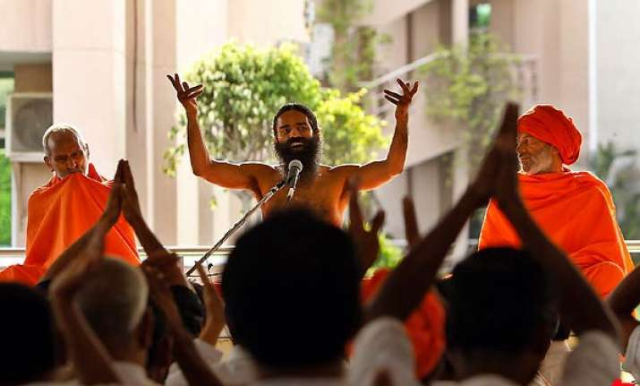 ramdev forgives pm cong accuses him of being rss agent