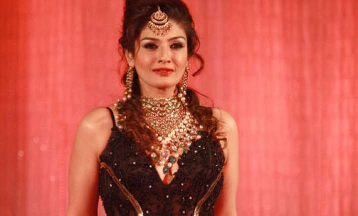 raveena tandon gets taste of potholed roads in mp