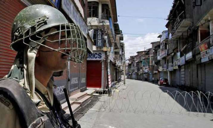 restrictions imposed in parts of srinagar as pm modi flags