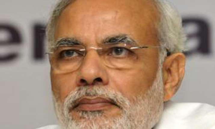 rights group wants narendra modi to be banned from uk