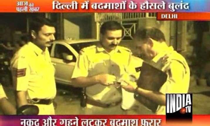 robbers thrash delhi woman inside her house loot cash