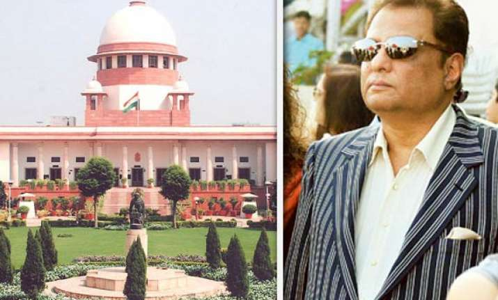 sit to probe black money centre asks sc to review order