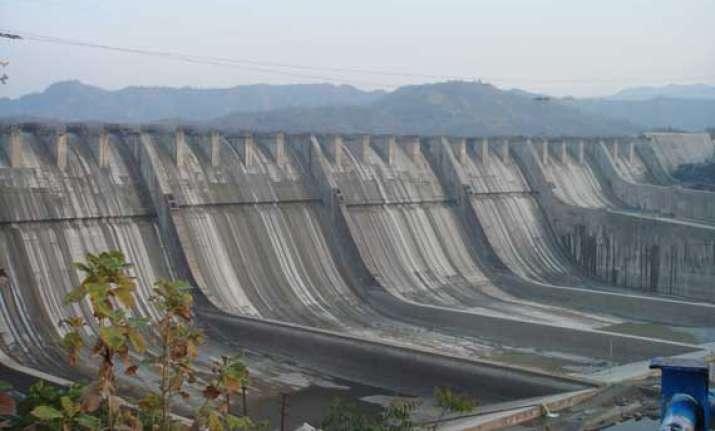 sardar sarovar dam cost to go up says gujarat chief minister