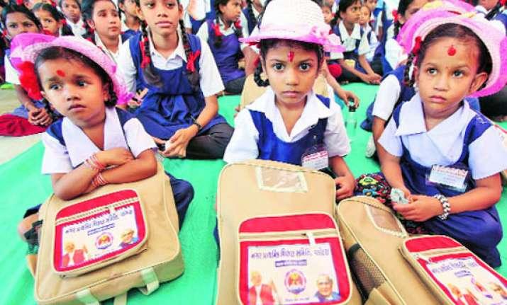 schoolbags with atal modi photos distributed in vadodara