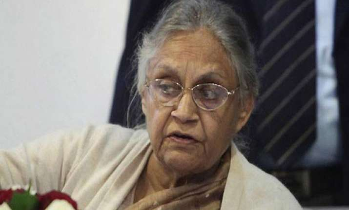 sheila dikshit warns private power companies over power cuts