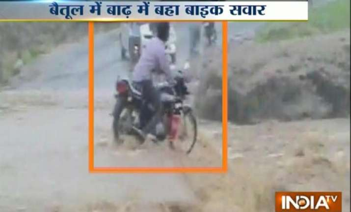 shocking video youth swept away by rain swollen river