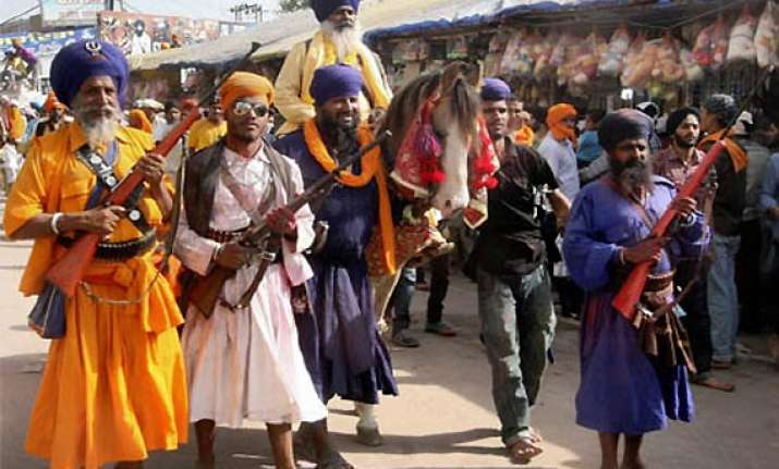 sikhs converge at anandpur sahib for hola mohalla