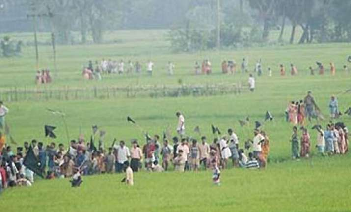 singur farmers celebrate issue of ordinance to return land