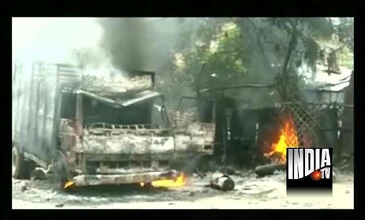 stoning arson in up town after customer s scuffle with bank