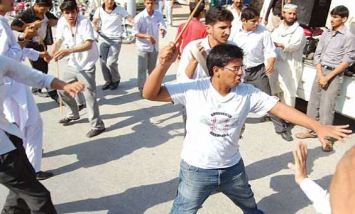 students block road protest against faulty inter results