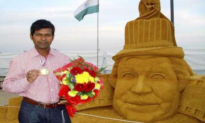 sudarshan pattnaik in sand sculpting world cup