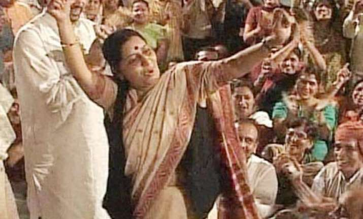 sushma s dance snowballs into a political row