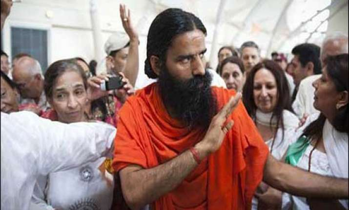 swami ramdev asks congress workers to remain humble