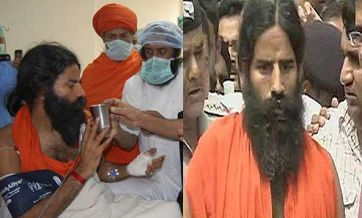 ramdev discharged from hospital vows to carry on campaign