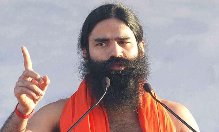 swami ramdev lashes out at gandhi family