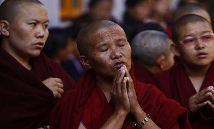 tibetan exiles offer prayers for flood hit