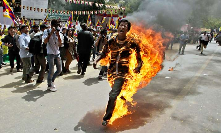 tibetan sets himself on fire in delhi hospitalized with