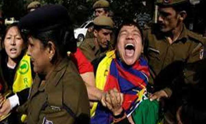 tibetans protest chinese foreign minister s visit