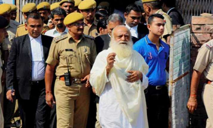 trial in asaram s case to continue even in his absence court