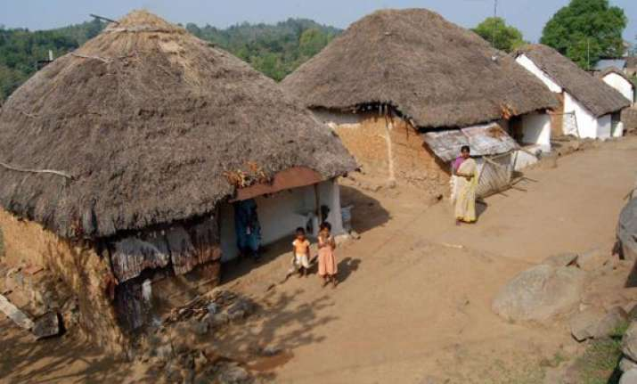 tribals accuse cops of thrashing them