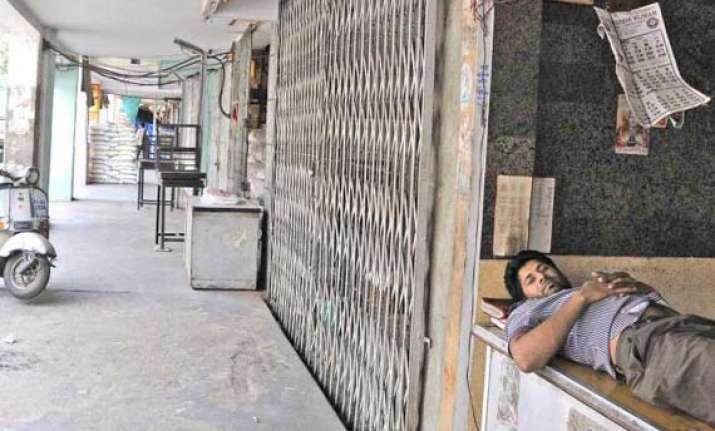 striking workers resort to arson in noida nationwide bandh