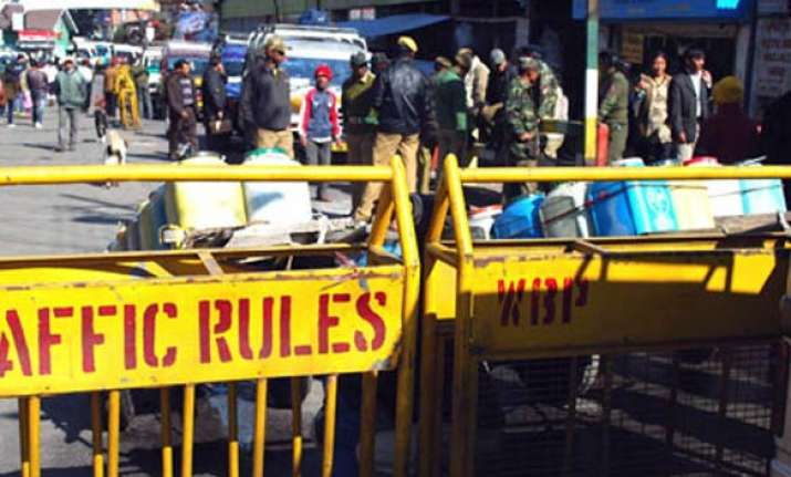 two killed in police firing vehicles torched in darjeeling