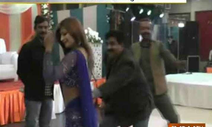 up minister caught on camera enjoying with female dancers