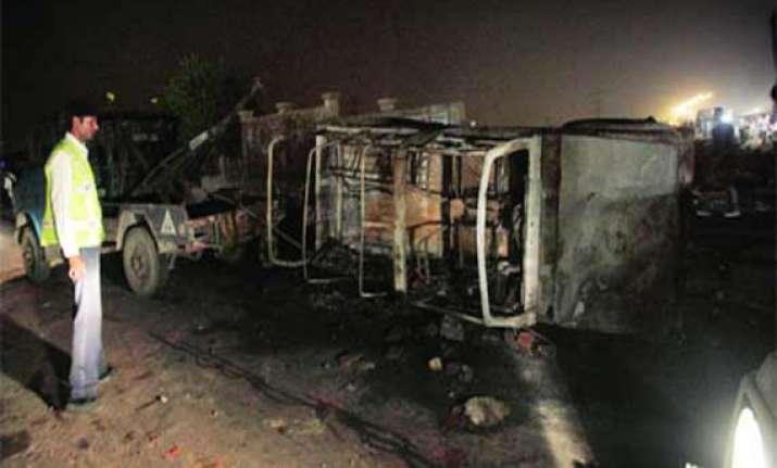 upsc protestors torch buses police booth in delhi