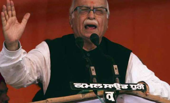 up barber detained for threat to harm l k advani