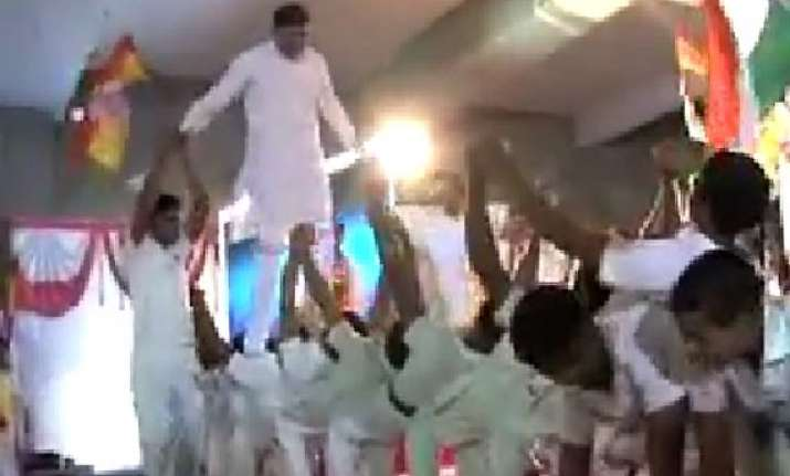 video of rajkot bjp candidate walking on school children