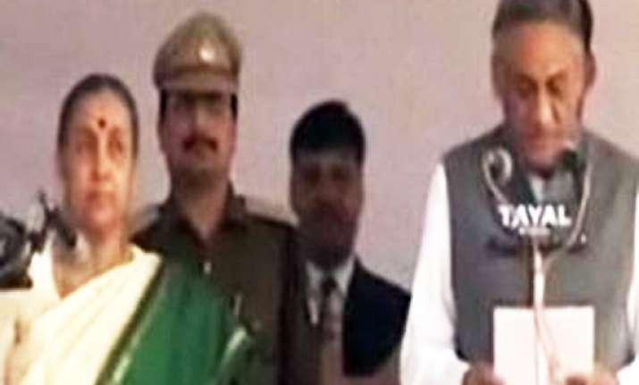 vijay bahuguna sworn in as uttarakhand cm amid revolt in