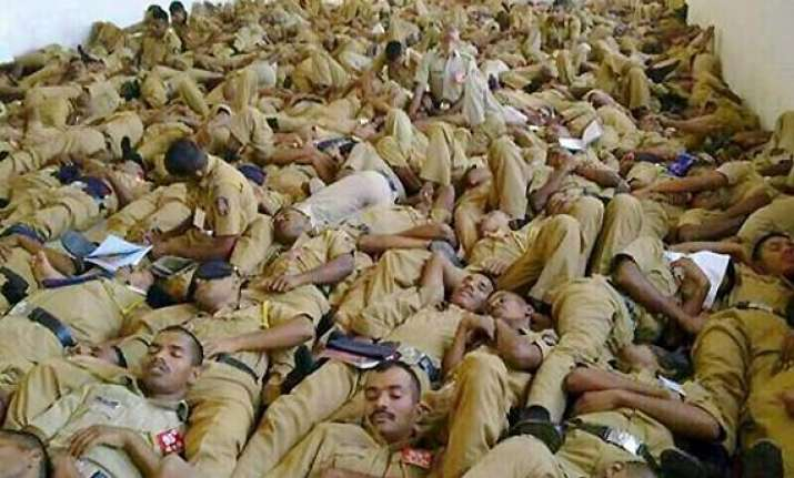 watch disturbing pic of indian policemen sleeping on one