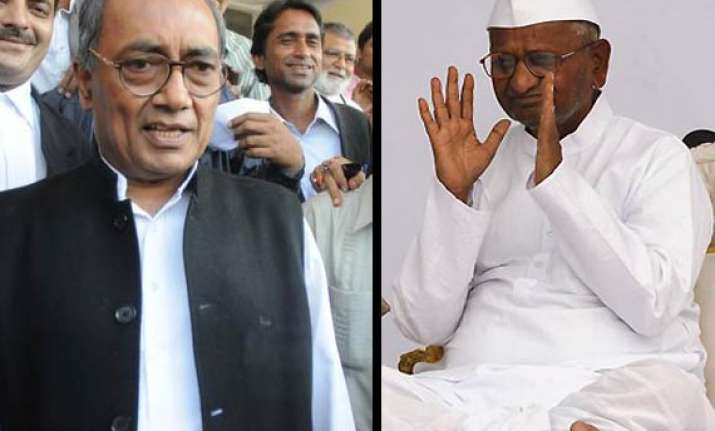 why are you soft on bjp digvijay asks anna hazare