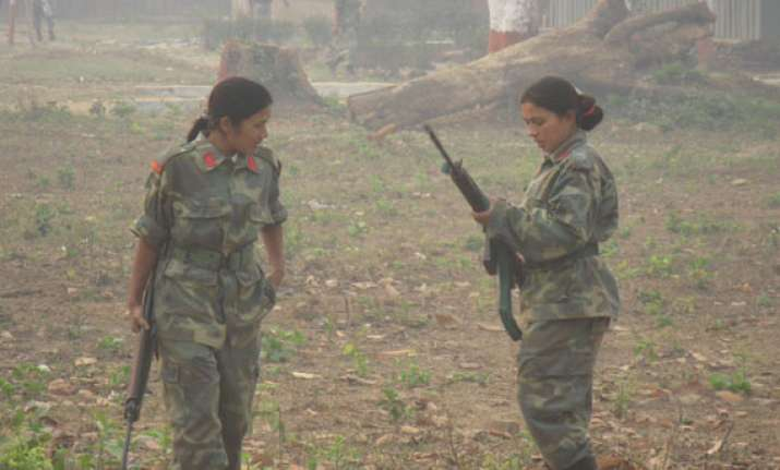 woman maoist carrying rs.100 000 reward surrenders in odisha