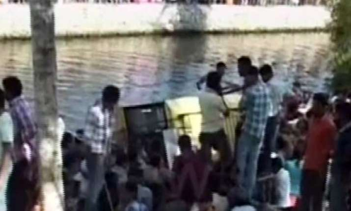 4 school kids die 15 go missing as bus falls into canal