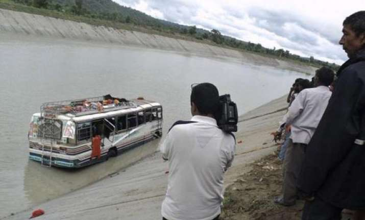 21 dead as bus falls into canal in up