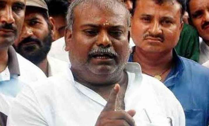 bihar police seize property of rape accused rjd mla raj