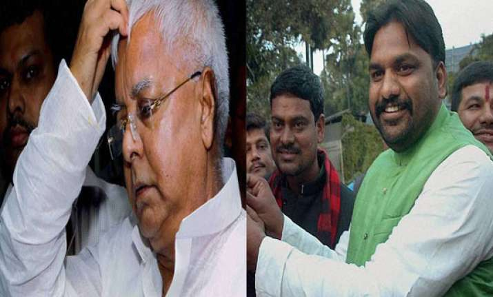 drama in patna lalu manages to stem revolt 6 out of 13