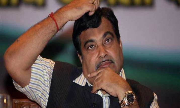 aap demands change of nitin gadkari s portfolio
