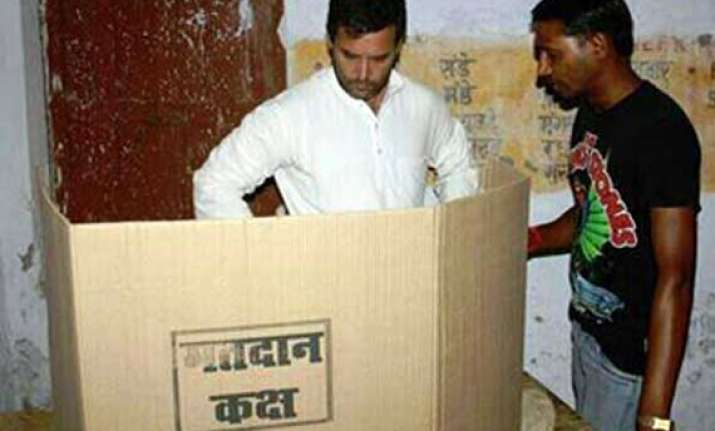 aap releases pictures of rahul gandhi inside amethi polling