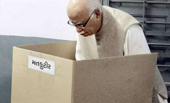 advani casts vote in gujarat parries queries on modi