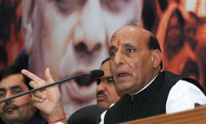 advani s remarks on modi was misinterpreted says rajnath