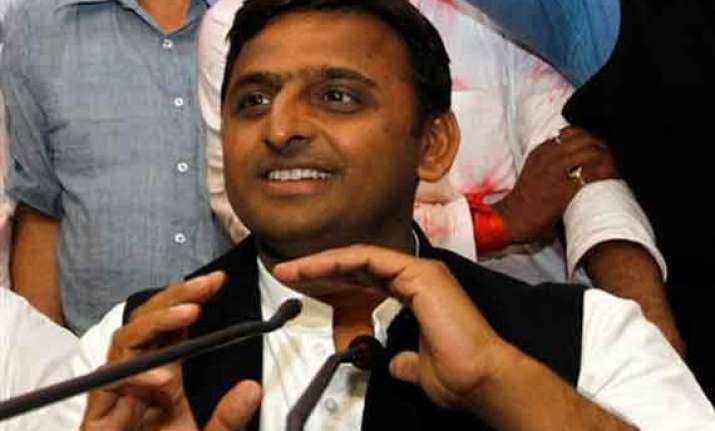 akhilesh defends vadra calls modi a model of dividing india