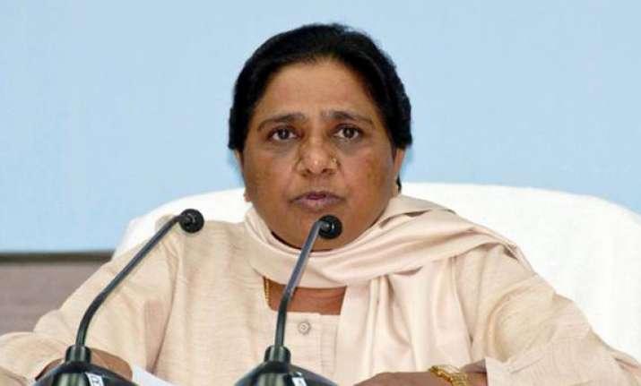akhilesh distributing laptops to sp workers says mayawati