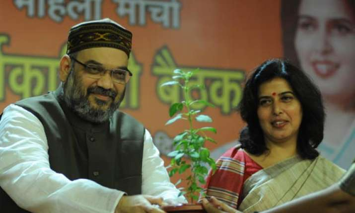 amit shah asks bjp women workers to highlight government s