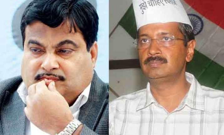 defamation delhi judge asks gadkari kejriwal to shake hands