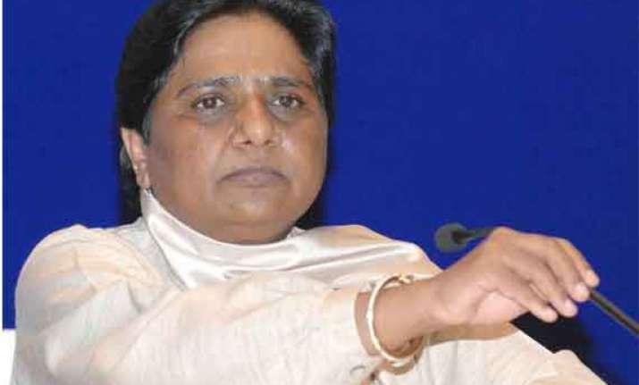bjp sp enacting drama in varanasi for poll gains mayawati
