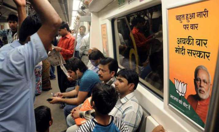 bjp flags 3 400 posters in metro trains congress yet to