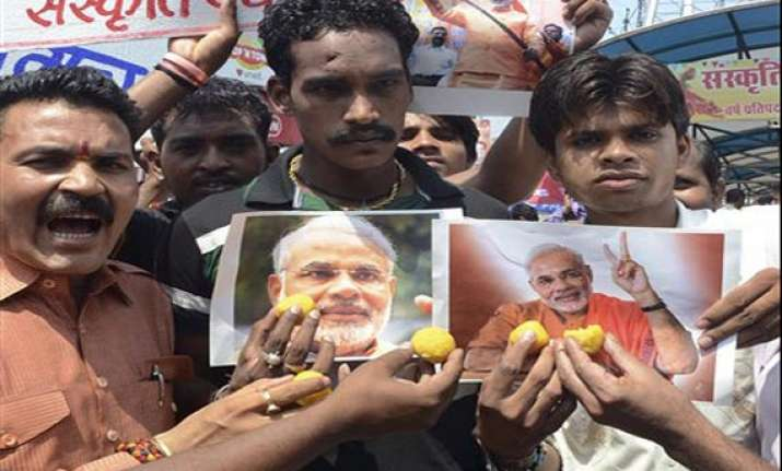 bjp leaders hail workers celebrate modi s appointment